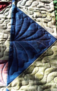 Setting Triangles....love quilting this style feathering!
